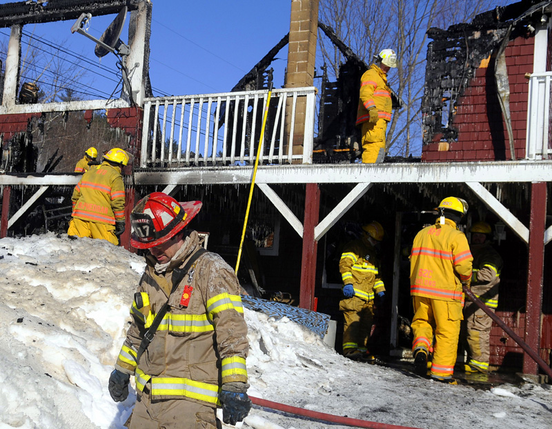 CRIME SCENE: Firefighters extinguish a blaze Wednesday on Church Road in Readfield that destroyed the home and killed at least one person.