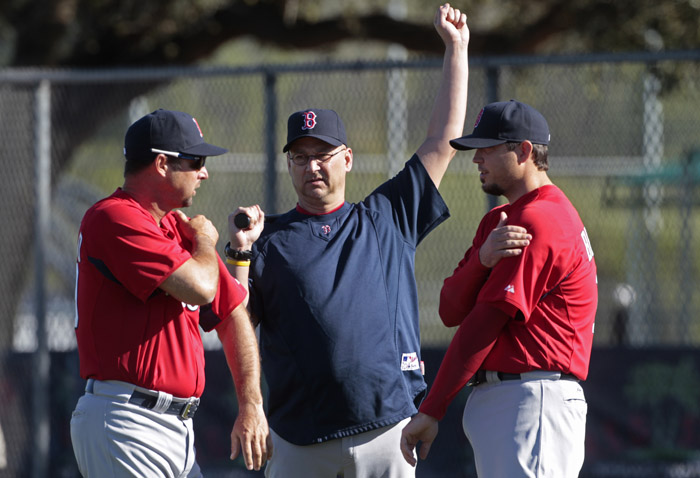 Boston Red Sox manager Terry Francona, center, talks with pitchers Tim Wakefield, left, and Josh Beckett at the beginning of their first day of spring training today.