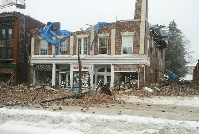 This photo provided by the Middletown, Conn., Police Department shows a partially collapsed building on Main Street in Middletown, Conn., Wednesday. Employees in the building escaped uninjured. The collapse came after days of heavy snowfall followed by rain.