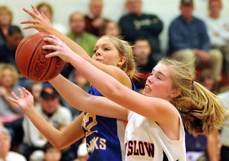 MAD SCRAMBLE: Winslow's Megan Richards, right, fights for the rebound with Hermon's Britney Hamlin in the third quarter of an Eastern Maine Class B preliminary game Tuesday night in Winslow. Winslow lost 40-33.