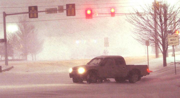 A truck gets stuck in the snow at a major intersection in Tulsa, Okla., today.