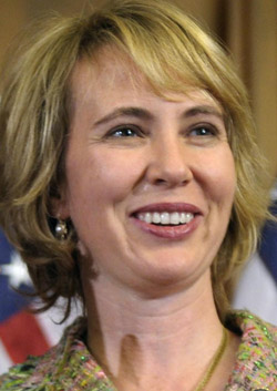 In this Jan. 5, 2011, photo – three days before she was shot in the head – Rep. Gabrielle Giffords, D-Ariz., takes part in a reenactment of her swearing-in, on Capitol Hill in Washington.