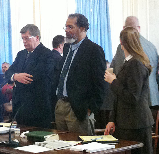 Rory Holland, center, listens as his sentence is handed down in York County Superior Court on Monday. His lawyers are standing with him – Cliff Strike on the left and Amanda Doherty on the right.