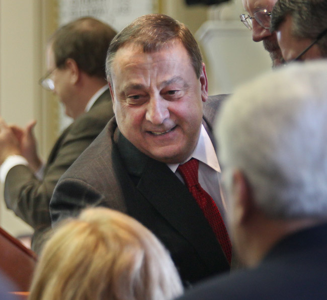 Gov. Paul LePage greets lawmakers as he prepares to announce his two-year state budget today in Augusta.