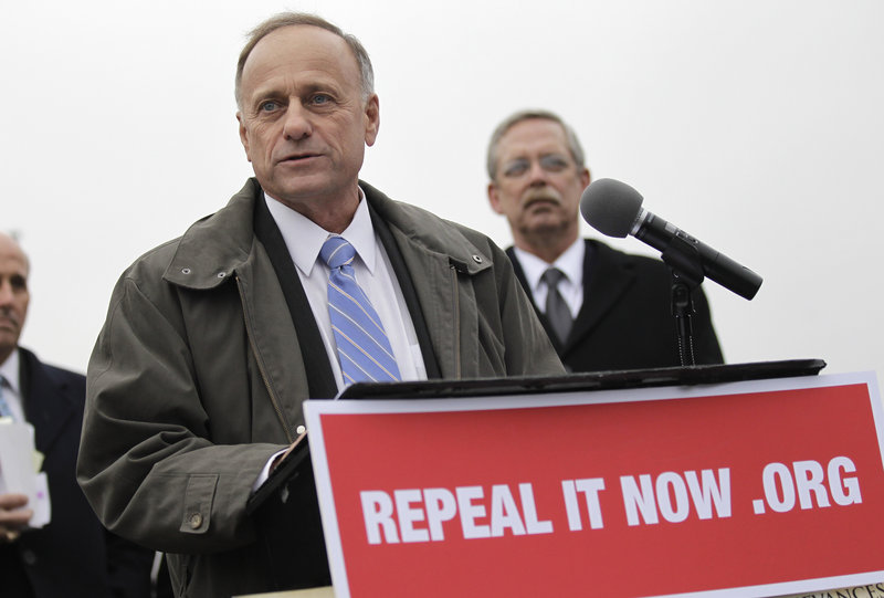Rep. Steve King, R-Iowa, left, a leader of the effort to repeal health care reform, speaks Jan. 18 in support of that effort.