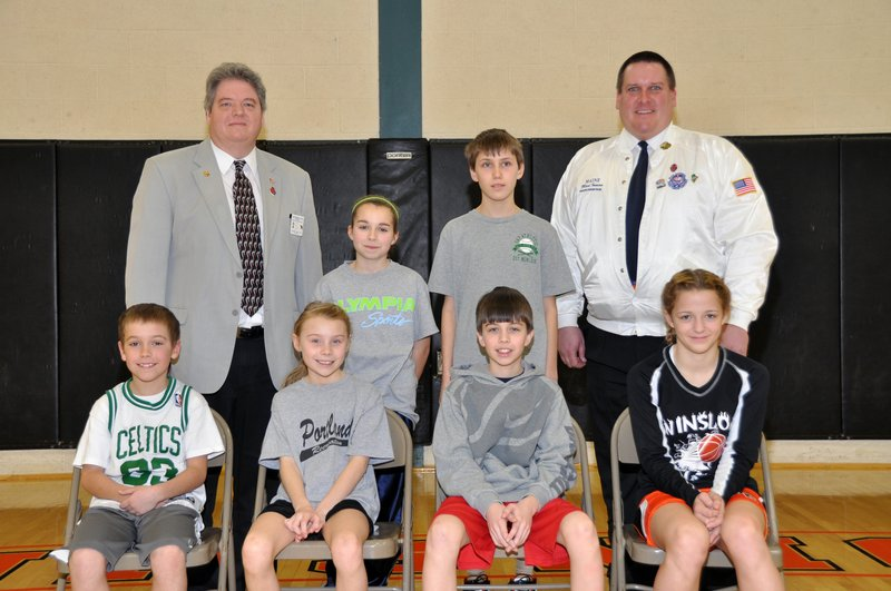 The Maine Elks Association's State Hoop Shoot champions were determined Sunday at Brunswick High School. The age-group winners were: Front, Henry Westphal (8-9 boys), Isabel Dawson (8-9 girls), Colby Esty (10-11 boys), Ciara LeClair (10-11 girls); Back, Caitlin Paradis (12-13 girls) and Stephan Gikas (12-13 boys), with MEA State President Roger Normandeau, back left, and State Hoop Shoot Director Mark Inman.