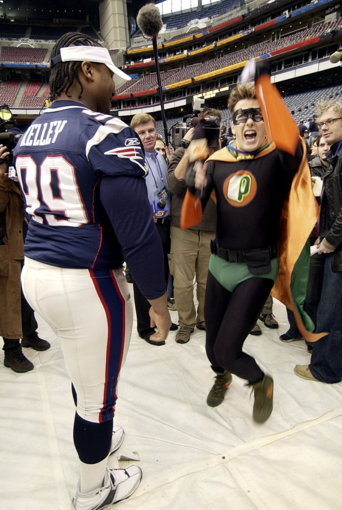 Ethan Kelley, a former backup defensive tackle for the New England Patriots, watches Nickelodeon's Pick Boy dance at the 2004 Super Bowl Media Day.