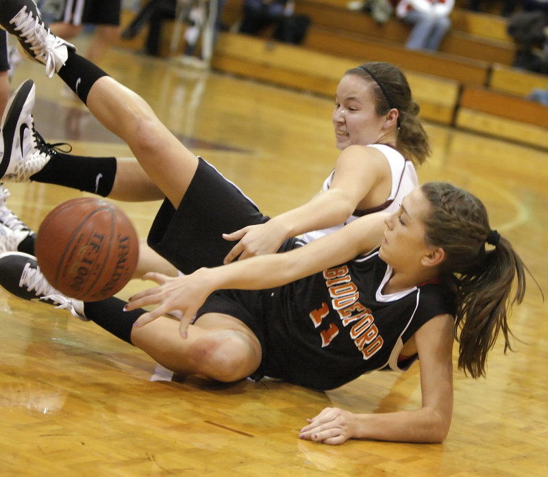 Alyson Roy, front, of Biddeford battles for a loose ball with Thornton Academy's Lauren Titus.