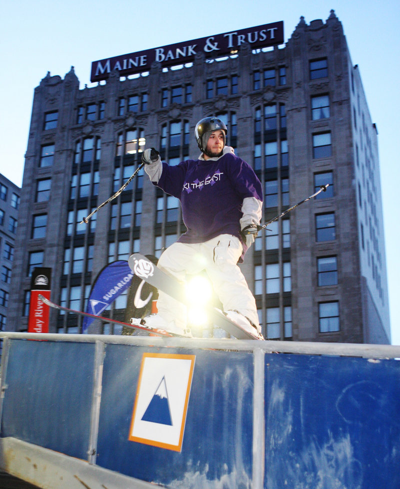 A skier competes in a previous Downtown Showdown in Portland's Monument Square. This year's event, starting at 5 p.m. Friday, will feature snowboarders and skiers performing tricks on rails and other constructed features.