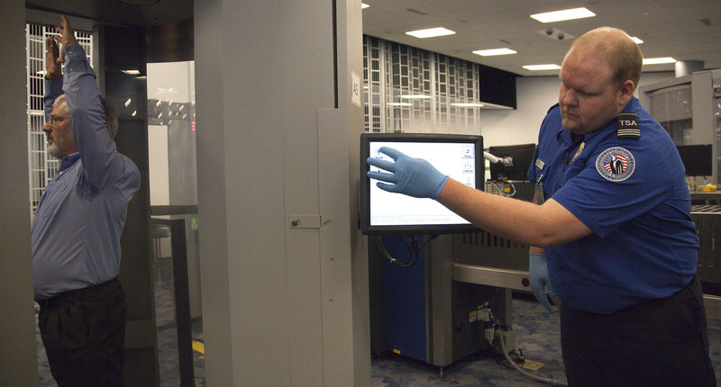 Transportation agency supervisor Nick Fox, right, demonstrates advanced imaging software that was being tested Tuesday at McCarran International Airport in Las Vegas.