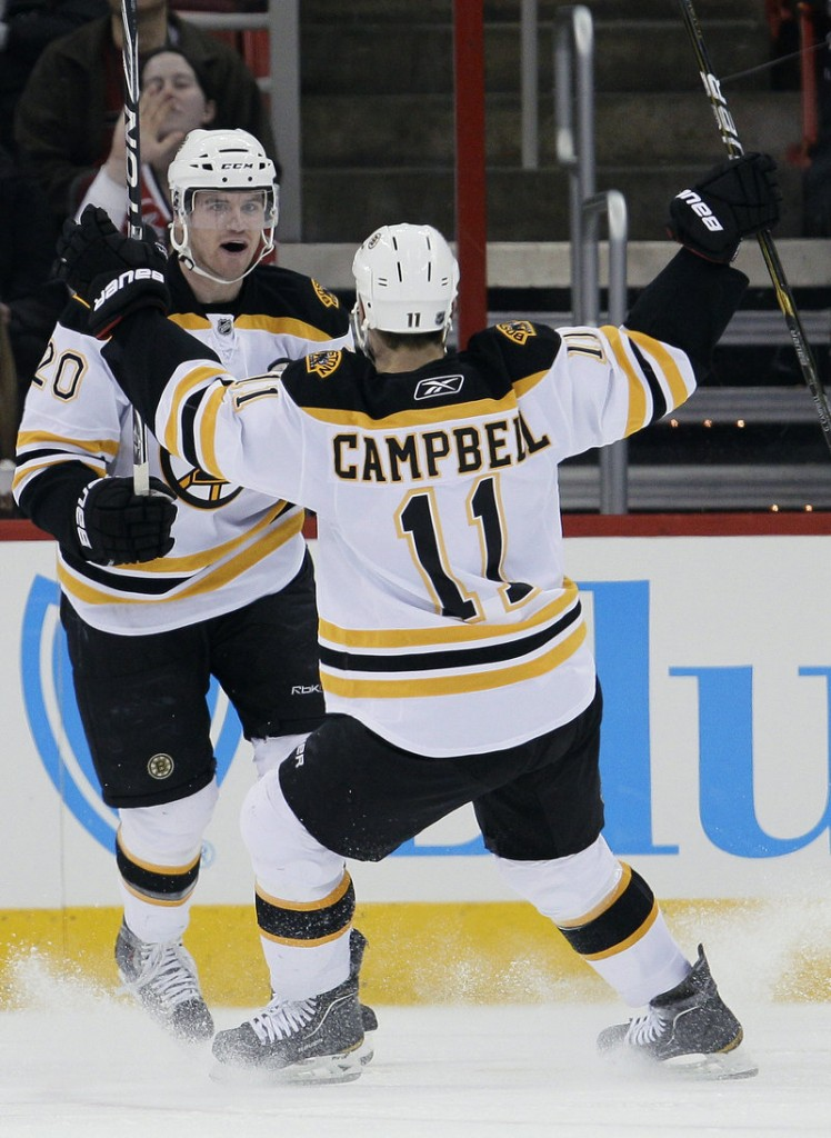 Boston's Daniel Paille, left, and Gregory Campbell celebrate Paille's second-period goal Tuesday night.