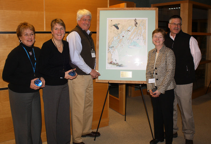 Members of the Bennett family, which owns Oakhurst Dairy, stand beside the Friends of Casco Bay Award they received at the event. From left, they are Althea Bennett McGirr, Mary Ellen Bennett Tetreau, Bill Bennett, Jean Bennett Driscoll and John Bennett.