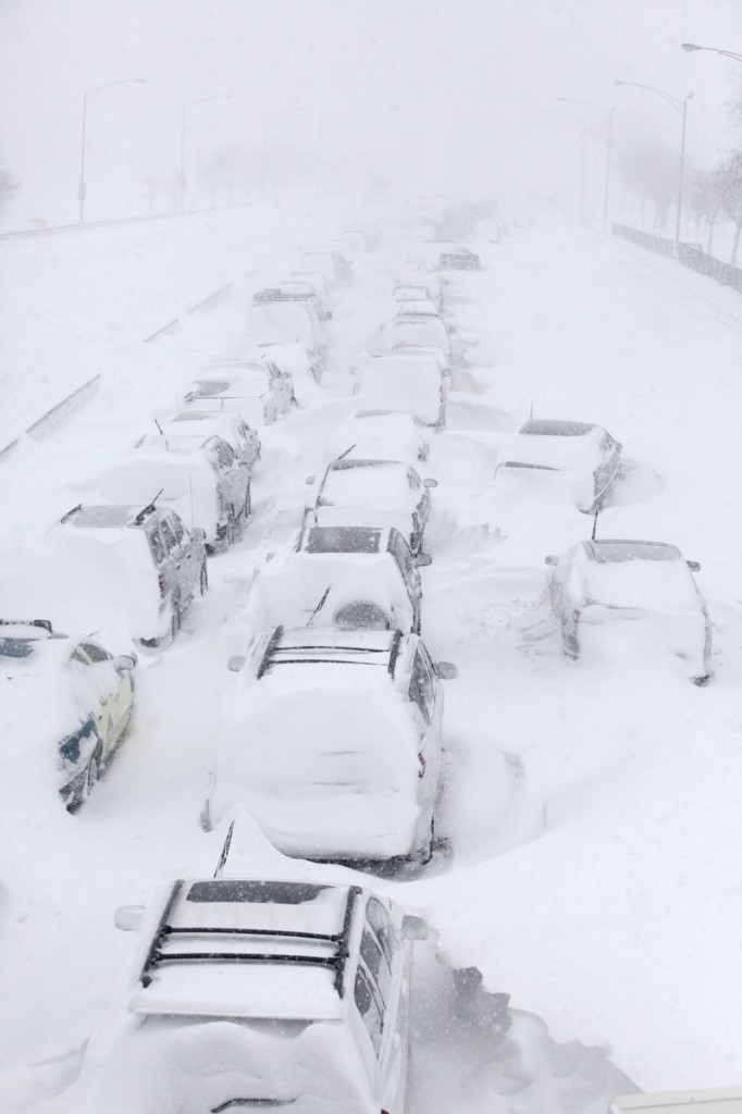 Stranded cars wait in ghostly lines Wednesday on Lake Shore Drive in Chicago after a blizzard dumped 20 inches on the city, the third-largest amount on record. Some drivers toughed out the wintry conditions for up to 12 hours overnight on the city's showcase thoroughfare.