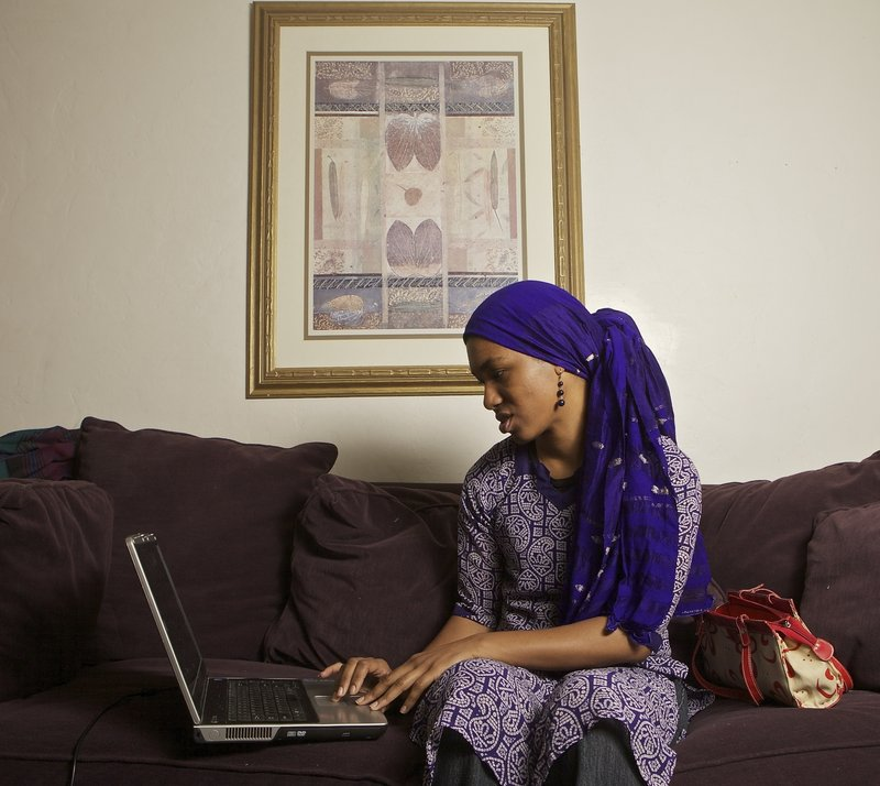 Producer-writer Khadijah Rashid works on a script at her home in Pasadena, Calif.