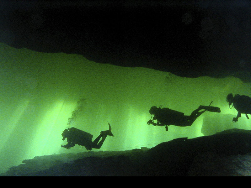 "Cave divers make their way though an underwater cave. Interest in the sport has increased recently with this weekend s release of ""Sanctum,"" an action-thriller movie from executive producer James Cameron."