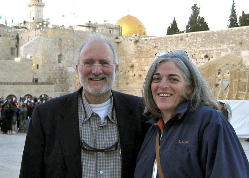 "Alan Gross, shown with his wife, Judy, in Jerusalem, has been charged with ""acts against the integrity and independence"" of Cuba."