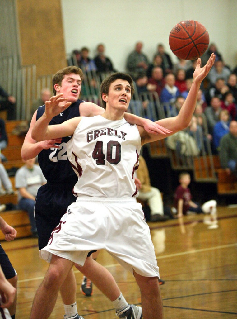 Tanner Storey of Greely holds inside position against Connor Ertz of Yarmouth while attempting to control a rebound Friday night in the first half of Yarmouth's 53-51 victory.
