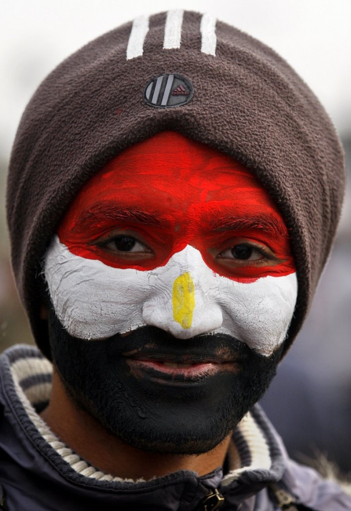 An anti-government protester wears the colors of the Egyptian flag on Friday in Cairo's Tahrir Square.