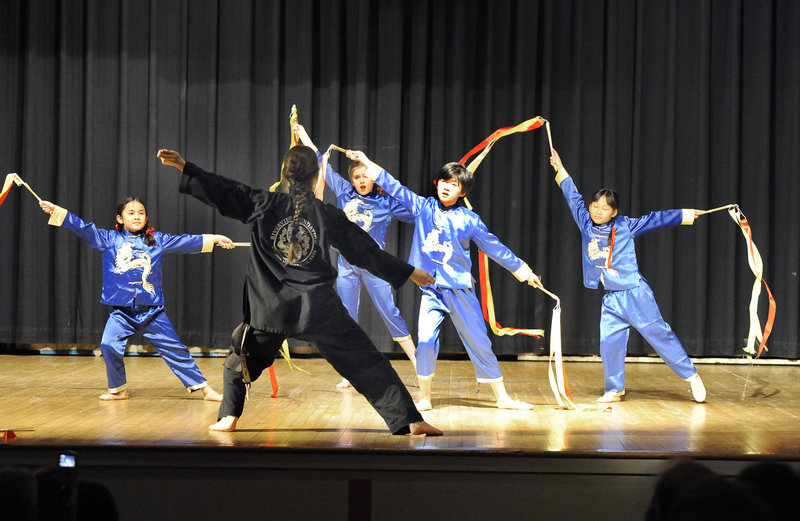 The Young Warriors Celebration bamboo class, led by Nina Henrikson, performs at a Chinese New Year celebration in Portland Saturday.