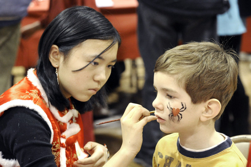 Rose Horowitz adorns 6-year-old Alexander Gordon of Portland.