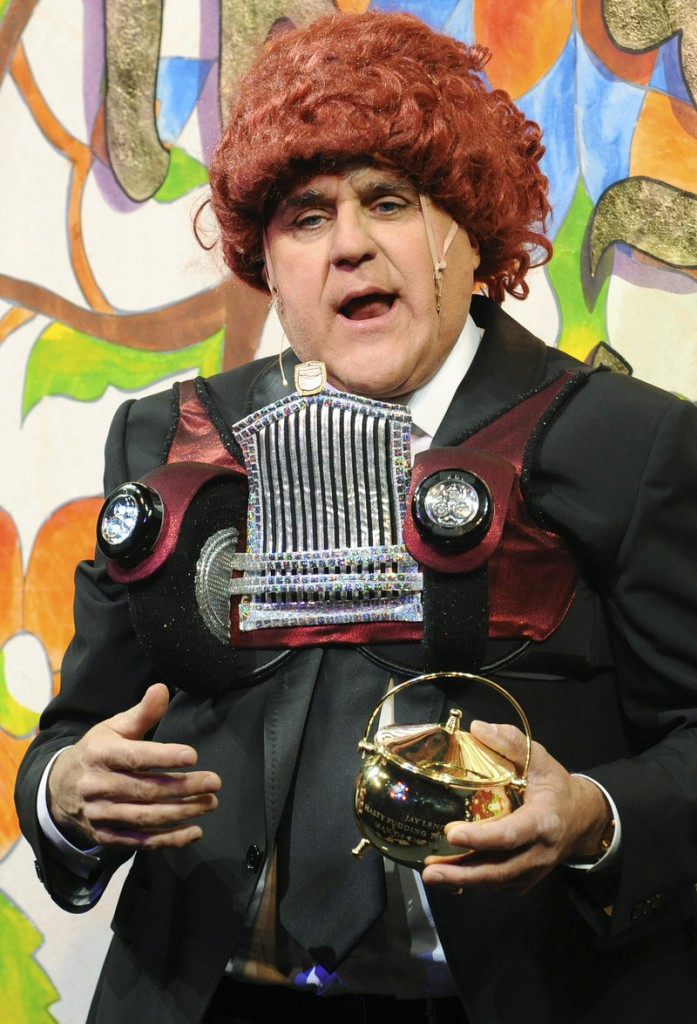 "Jay Leno, host of ""Tonight,"" holds the Hasty Pudding pot and chats with the audience Friday after he was honored as the 2011 Man of the Year at Harvard University."