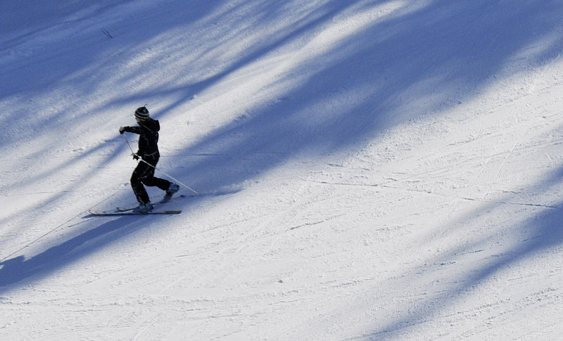 A telemark skier descends a trail during the festival. A festival organizer, Biff Higgison, says telemark
