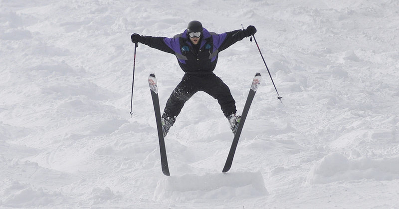 Andy Gale of Cambridge, Mass., does a spread eagle during the mogul competition at The Maine Telemark Festival at Sunday River in Newry on Saturday.
