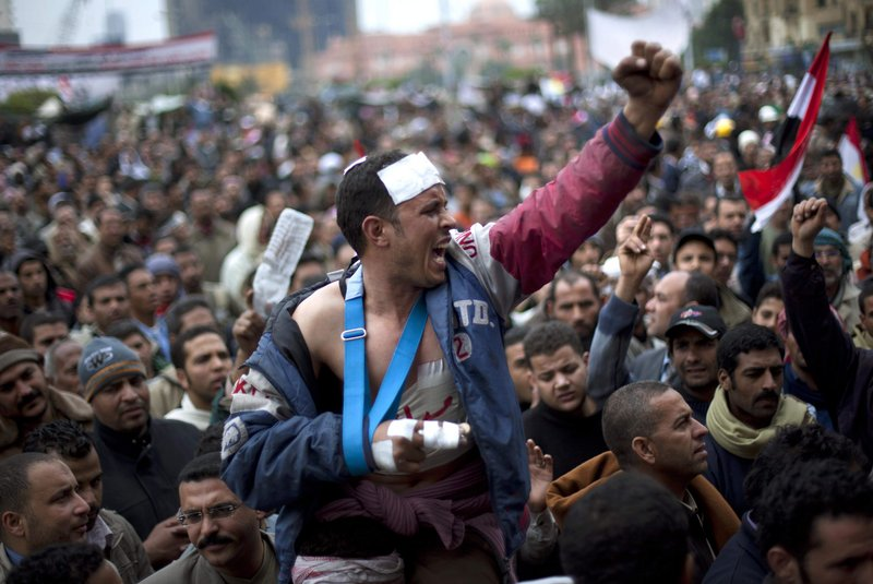 Egyptian anti-Mubarak protesters shout slogans during a demonstration in Tahrir Square in Cairo, Egypt, on Saturday.