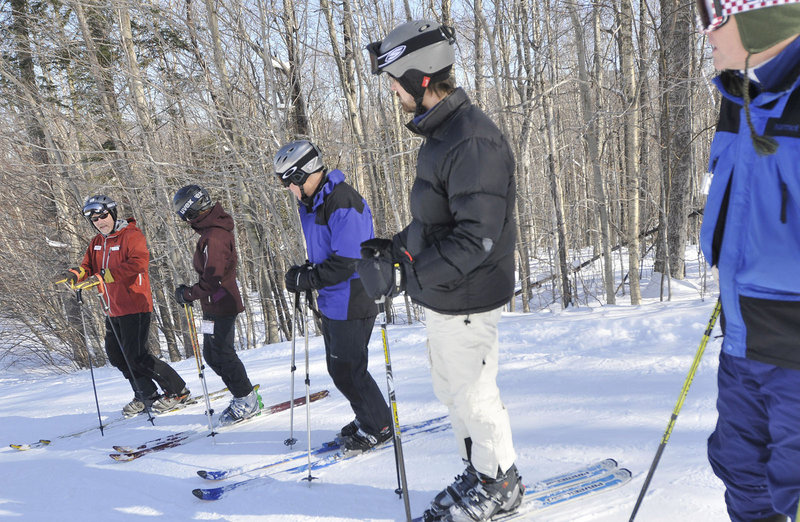 Instructor Ray Walters, of Concord N.H., far left, gives advice during a telemark lesson Saturday.