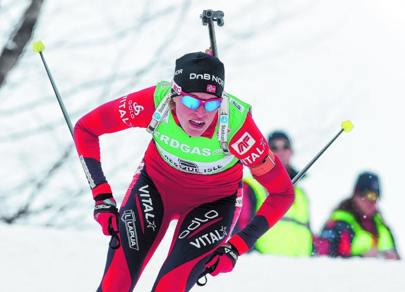 Tora Berger of Norway races down a hill on her way to victory in the women's 10K pursuit Sunday in Presque Isle. Berger won the race in 35 minutes, 12.1 seconds.