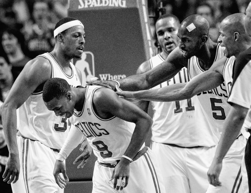 Boston's Rajon Rondo is surrounded by teammates, from right, Ray Allen, Kevin Garnett Glen Davis and Paul Pierce, during the second half of the Celtics' 91-80 win over the Orlando Magic on Sunday at Boston. Rondo had a season-high 26 points.