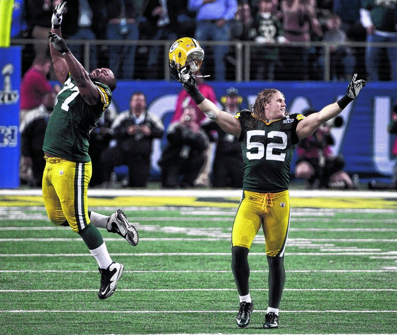Green Bay's Cullen Jenkins, left, and Clay Matthews celebrate after a late defensive stand clinched a 31-25 win over Pittsburgh in the Super Bowl on Sunday night in Arlington, Texas. Green Bay won the NFL title for a record 13th time – its fourth of the Super Bowl era and its first in 14 years.