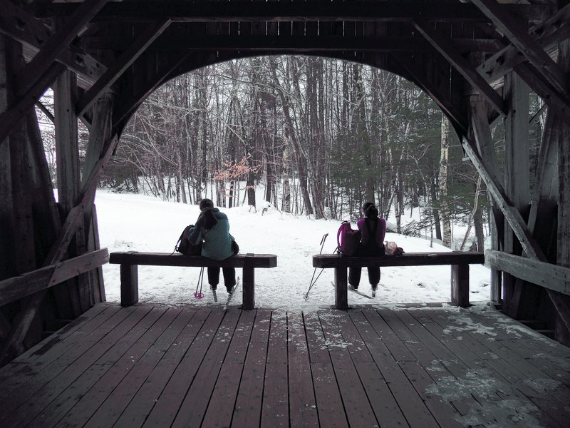 The Artists' Covered Bridge offers a picturesque place to stop while cross-country skiing at Sunday River in Newry.