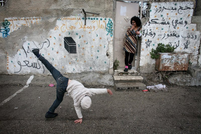 A Palestinian boy plays outside his house Monday in the east Jerusalem neighborhood of Sheikh Jarrah. The plan for Jewish homes must clear bureaucratic obstacles.