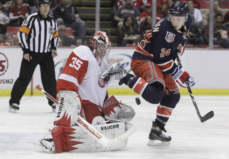 Ryan Callahan of the New York Rangers plays the puck in front of Detroit goalie Jimmy Howard during the second period of the Red Wings' 3-2 win at Detroit on Monday.