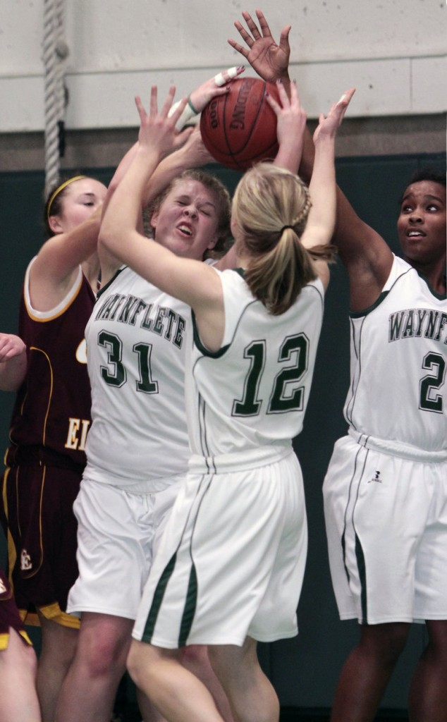 Waynflete's Liz Lewis (31), Martha Veroneau (12) and Rhiannan Jackson (2) work together to come down with a rebound Monday against Cape Elizabeth at Waynflete.