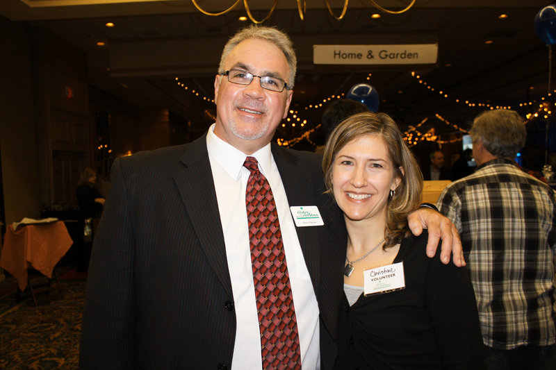 Board member and WGAN Morning News co-host Mike Violette and volunteer Christine Chasse.