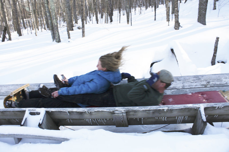 Shannon Bryan teams up with Bruce Richards for a toboggan ride at the Camden Snow Bowl.