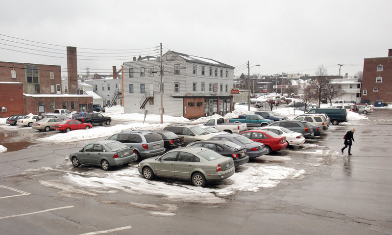 This public parking lot at Franklin and Federal streets in Biddeford, photographed Tuesday, is one of the proposed areas for a $15 million parking garage the city wants to build downtown. The structure would likely be funded by a portion of taxes from Biddeford Crossing.