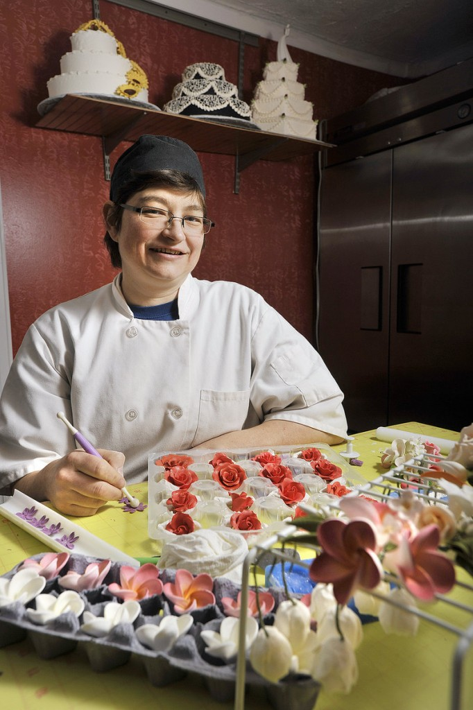 Michele Gonneville, owner of Edible Delights in Old Orchard Beach, creates intricate gum paste flowers for her wedding cakes. She also makes cakes for other functions, and pastries, dessert bars and whoopie pies.