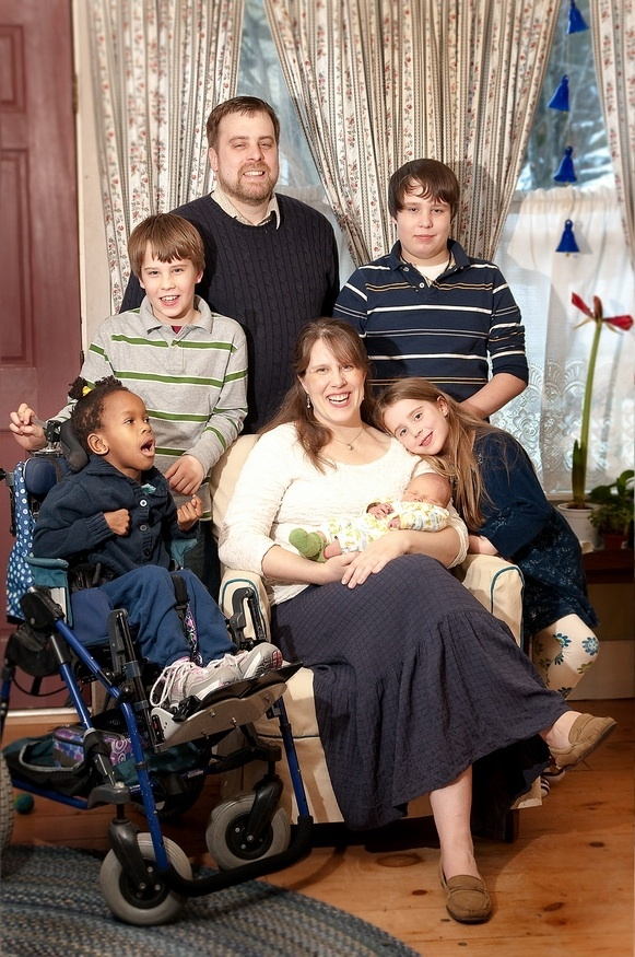 Ruth Merrill, 7, left, is pictured with her family this month: parents Dana and Meadow Merrill and their children, Gabriel, 11; Judah, 13; Lydia, 7; and Asher, 1.