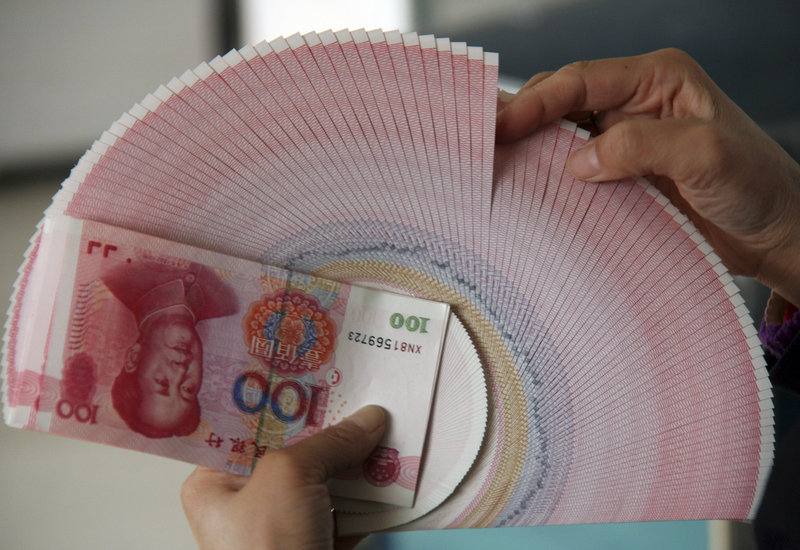 A bank teller count bank notes at a bank in Linyi, China. China's central bank raised interest rates for the second time in just over a month in a bid to dampen high inflation.