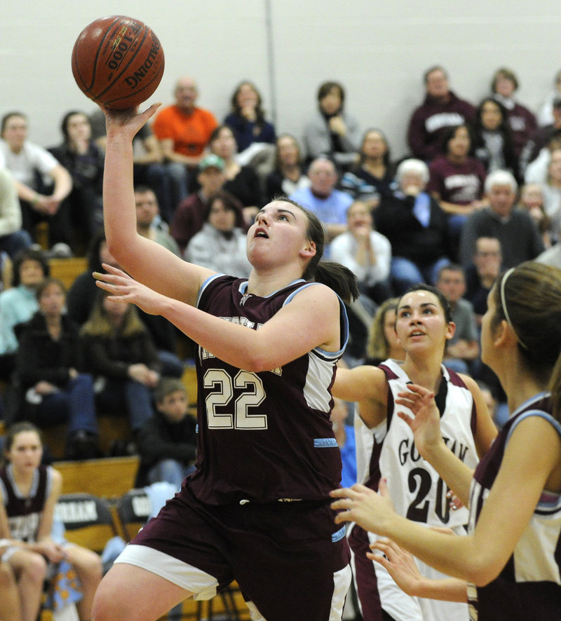 Gina Cirillo of Windham gets past Gorham's Natalie Egbert for a layup Tuesday night at Gorham. Gorham rode a strong second half to a 58-43 victory.