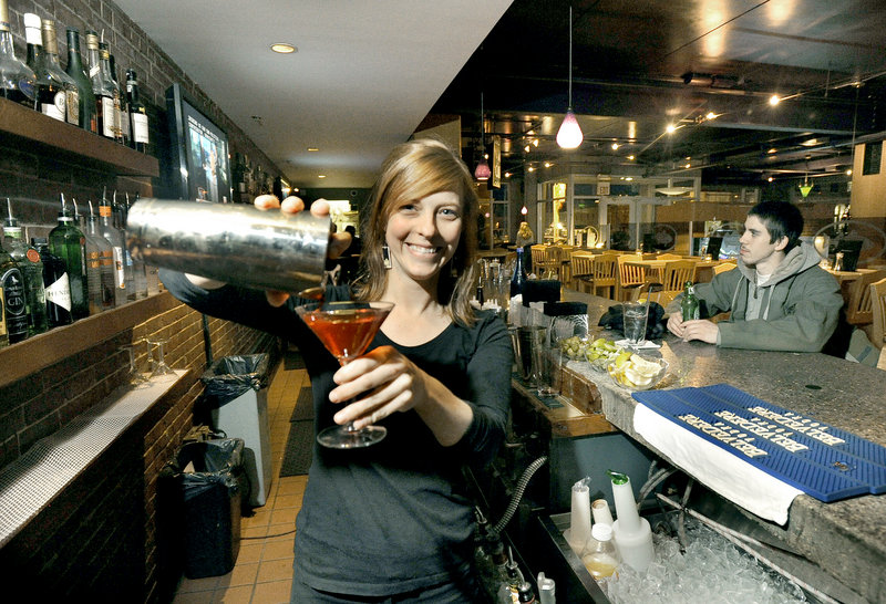 Bartender Angela Haven gets to work at Old Port Sea Grill.