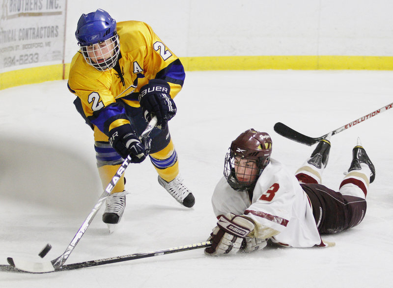 Sam Canales of Thornton Academy dives in an attempt to stop Tim Hanley of Falmouth from clearing the puck. The teams will meet again Feb. 19 in Falmouth.