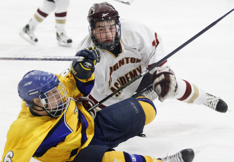 Sam Canales of Thornton Academy lays a check on Andre Clement of Falmouth after Clement got off a shot. Thornton improved to 9-5 with the victory. Falmouth dropped to 6-5-3.