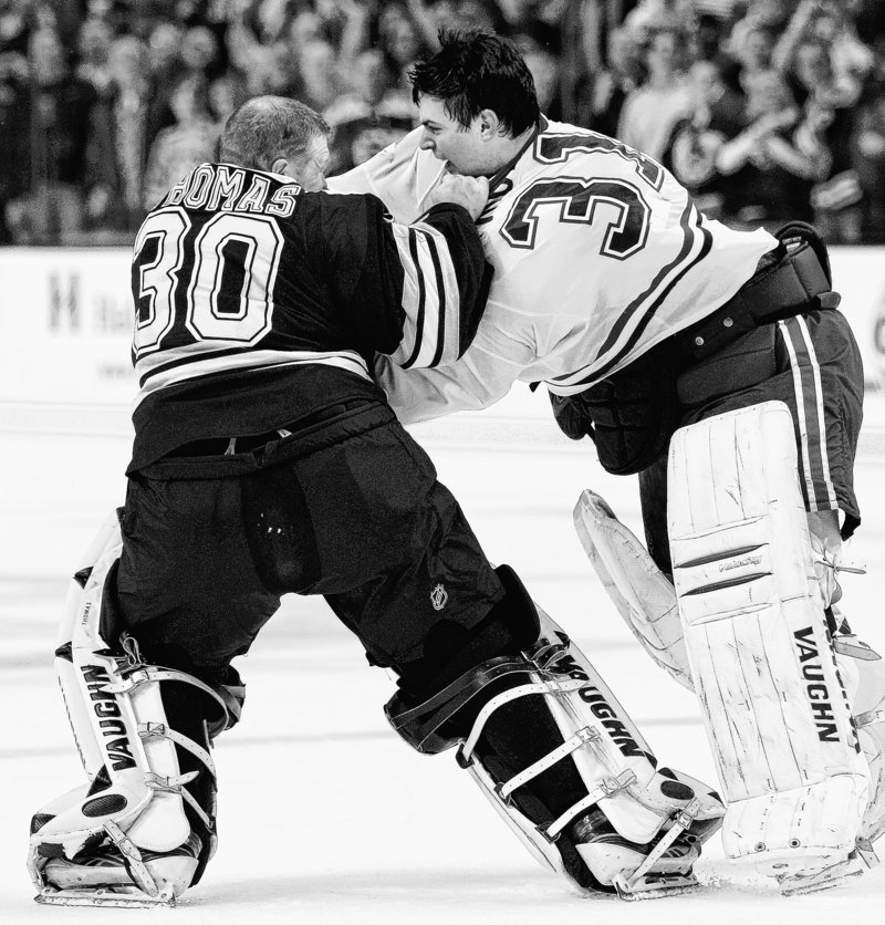Tim Thomas of the Boston Bruins, left, attempts to raise the shirt of his Montreal counterpart, Carey Price, during a goalie showdown in Boston's 8-6 victory Wednesday.