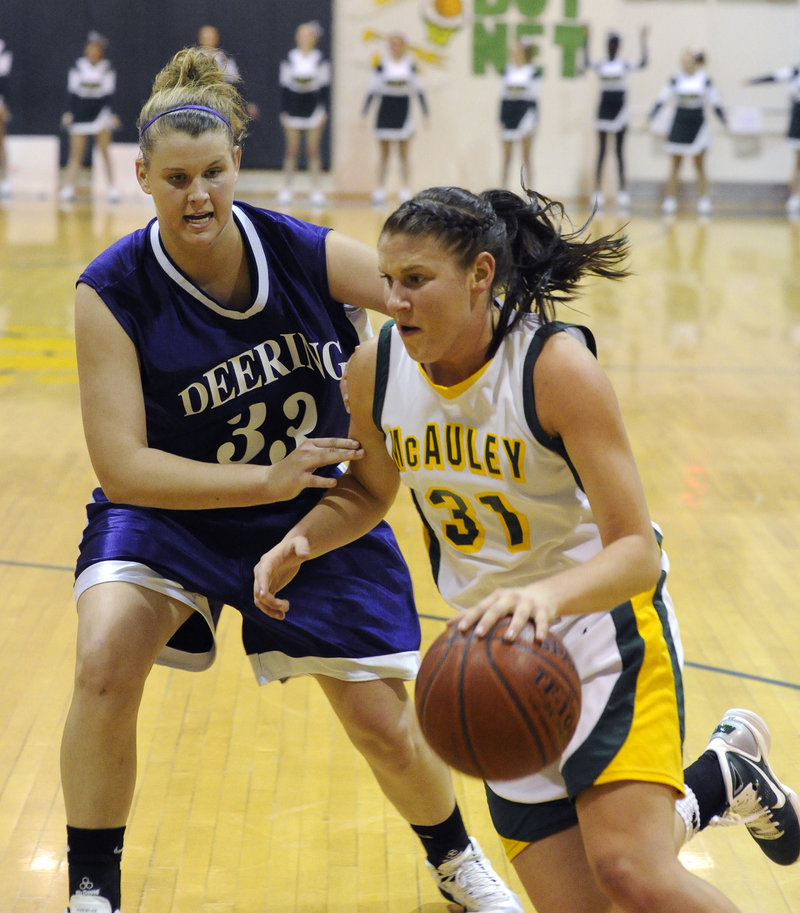 Rebecca Knight of McAuley, who was held to eight points, looks for room to drive against Kayla Burchill of Deering during Deering's 38-35 victory Thursday night.