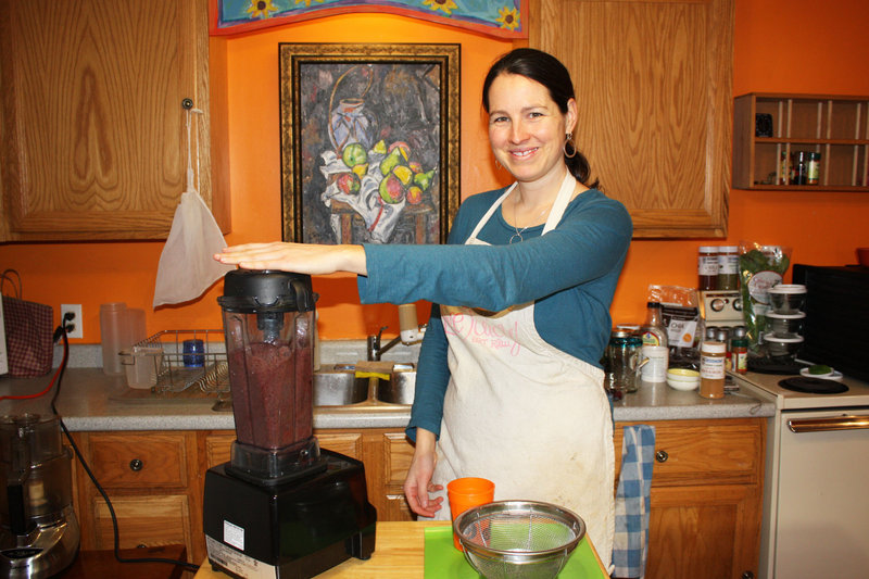 Elizabeth Fraser creates a smoothie from kale, blackberries, blueberries, bananas, cinnamon and water in her Munjoy Hill demonstration kitchen.
