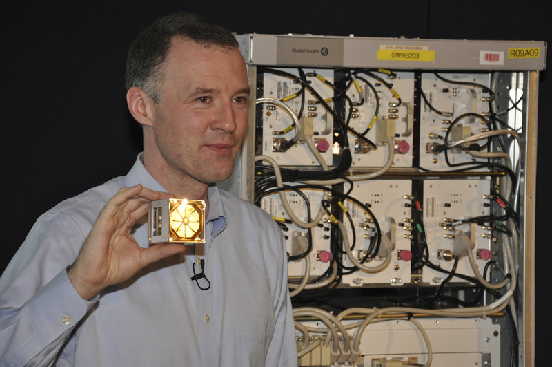 Wim Sweldens, president of Alcatel-Lucent's wireless division, holds a lightRadio cube, a cell-phone antenna that could go anywhere.